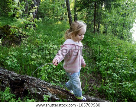 3 years old girl walk in forest