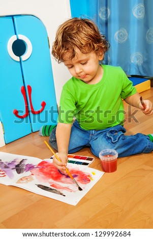 2 years old kid painting with watercolors drawing image - stock photo