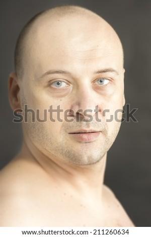 38 years old man looking at camera bold head no t-shirt  - stock photo