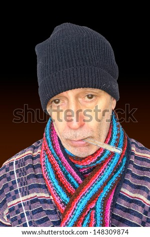 50 years old man, with the flu and temperature, keeping a thermometer in his mouth, wearing a cap and a woolen scarf, isolated on black background