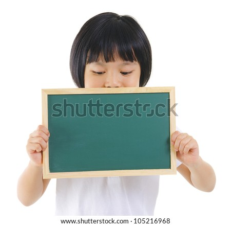 7 years old pan Asian school girl covered her mouth with blackboard on white background - stock photo
