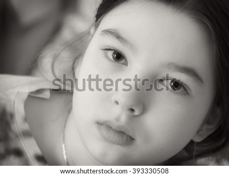 9-10 years old teen girl. Black and white portrait - stock photo