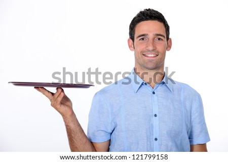 35 years old waiter wearing a casual shirt - stock photo