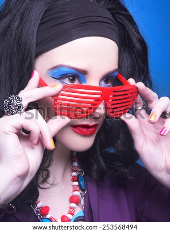 80-years style. Young woman with bright visage with vintage telephone. - stock photo