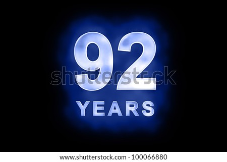 92 years text with blue glow on black background - stock photo