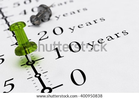 10 years written on a paper with a blue pushpin, concept image for business vision or long term prospective. 3d illustration. - stock photo