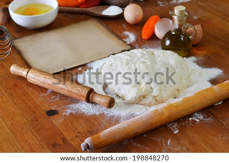 yeast dough, old sheet  and flour on wooden background - stock photo