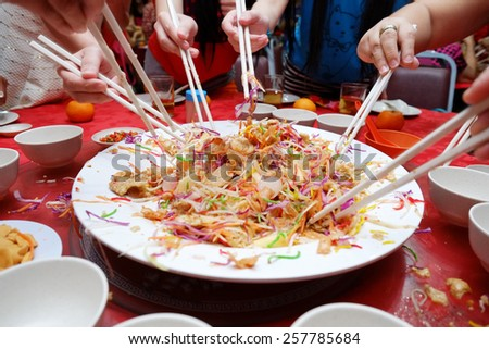 2015 Yee Sang Chinese New Year Dish for Prosperity Toss Celebration also known by Yu Sheng Spring Toss - stock photo