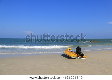 Yellow boat on the beach and blue sky