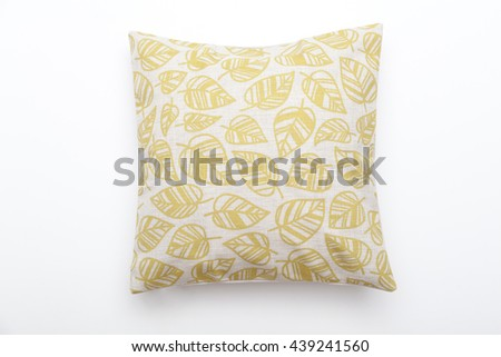 yellow leave pattern pillow isolated on white - stock photo