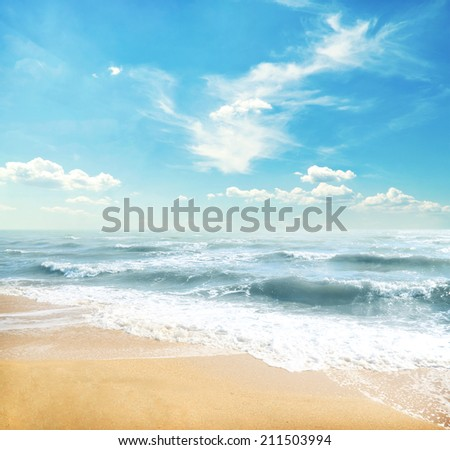 Yellow sand beach and blue sky and sea - stock photo