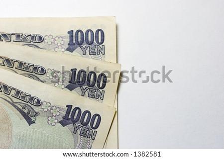 1000 yen bills fanned - stock photo