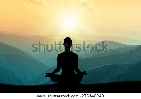 Yoga and meditation. Silhouette. - stock photo