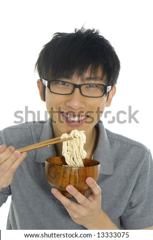 young Asian boy eating food - stock photo