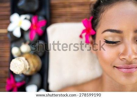 Young Asian woman Relaxing in spa - stock photo