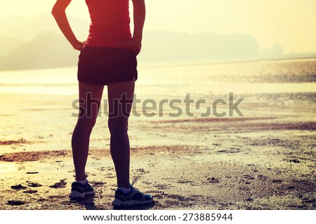 young asian woman runner on beach