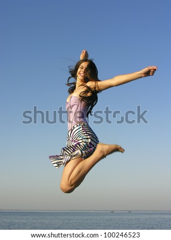 young attractive woman jumping outdoors