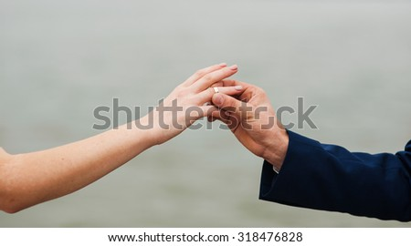 Young beautiful couple holding hands