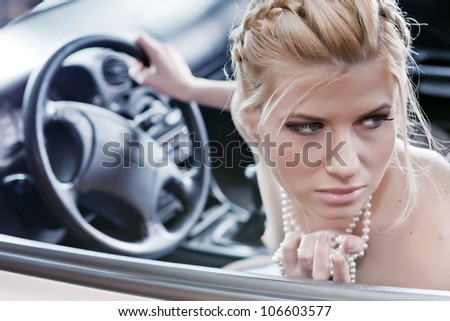 Young beautiful woman driving a car.