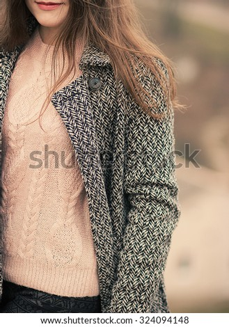 young beautiful woman in autumn coat. Fashion photo - stock photo