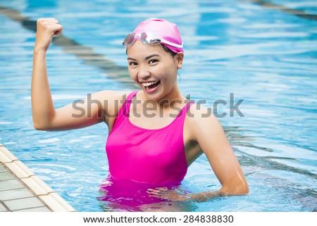young beautiful woman  in swimming pool - stock photo