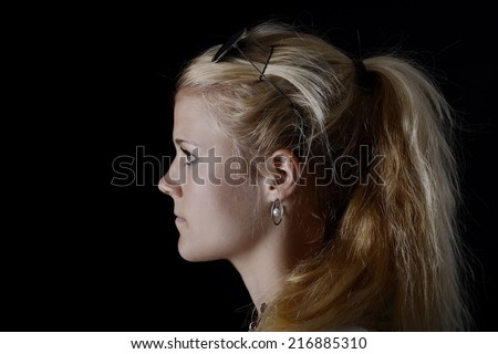 young blond woman with ponytail and sunglasses - stock photo