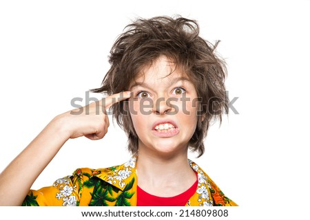 young boy killing himself metaphoricall - stock photo