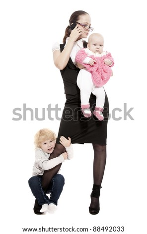 Young business lady with her little children - stock photo