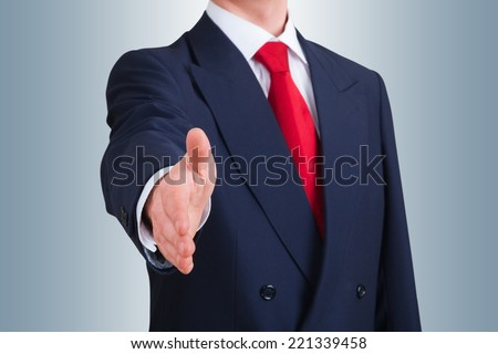 young business man offering to shake hands. Clipping path included - stock photo