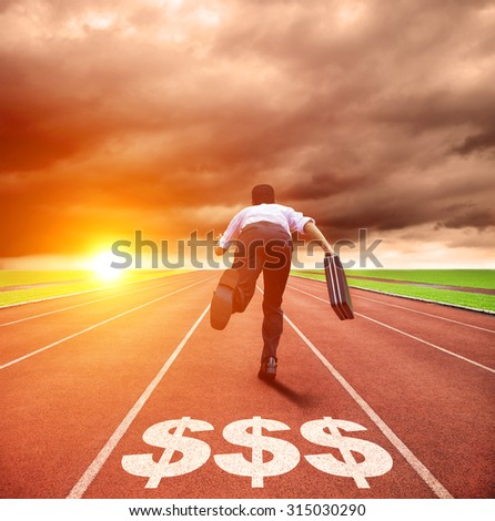 young business man running on track with money sign - stock photo