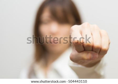 young business woman holding her hands up.