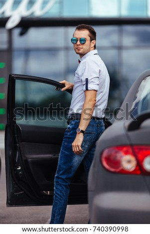 Young businessman at the car