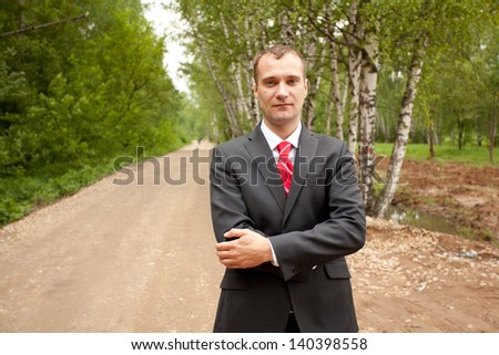 Young businessman at the city park - stock photo