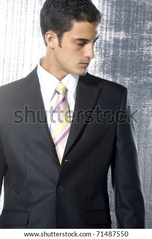 Young businessman in a suit isolated shot in studio