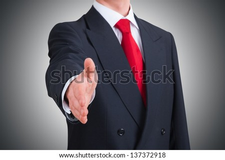 young businessman offering to shake hands. Clipping path included - stock photo