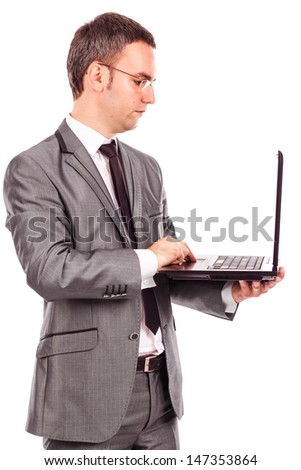 Young businessman using laptop against  white background