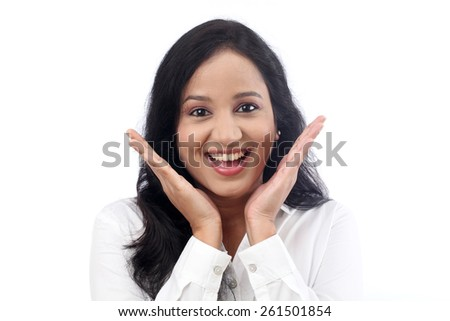 Young businesswoman smiling with open palms - stock photo