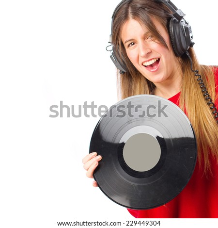 young cool girl with headphones and vinyl