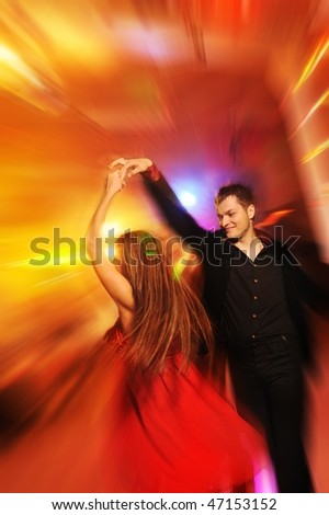 Young couple dancing in the night club - stock photo