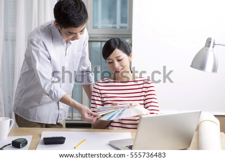 Young couple to use a computer at home