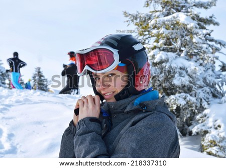 Young girl preparing for skiing - stock photo