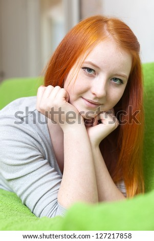 young girl relaxing on couch in livingroom room