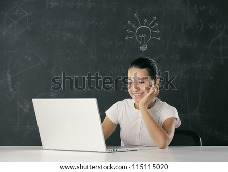 young girl with a big idea and the light bulb turns on. - stock photo