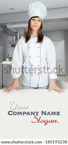 Young girl with a chef uniform in an industrial kitchen  - stock photo