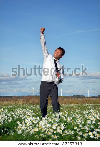 young, handsome businessman showing excitement of a successful deal - stock photo