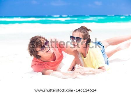 young happy couple having fun on the beach. tulum, mexico - stock photo