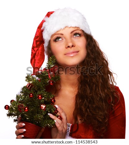 Young happy woman in santa dreaming over white