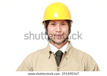 young Japanese construction worker smiles