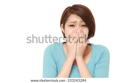 young Japanese woman shocked - stock photo