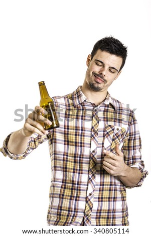 young man drinking beer from a bottle against a white background - stock photo